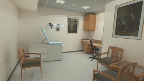 Exam room in VR classroom with table, chairs, desk, cabinets and other nurse training assets